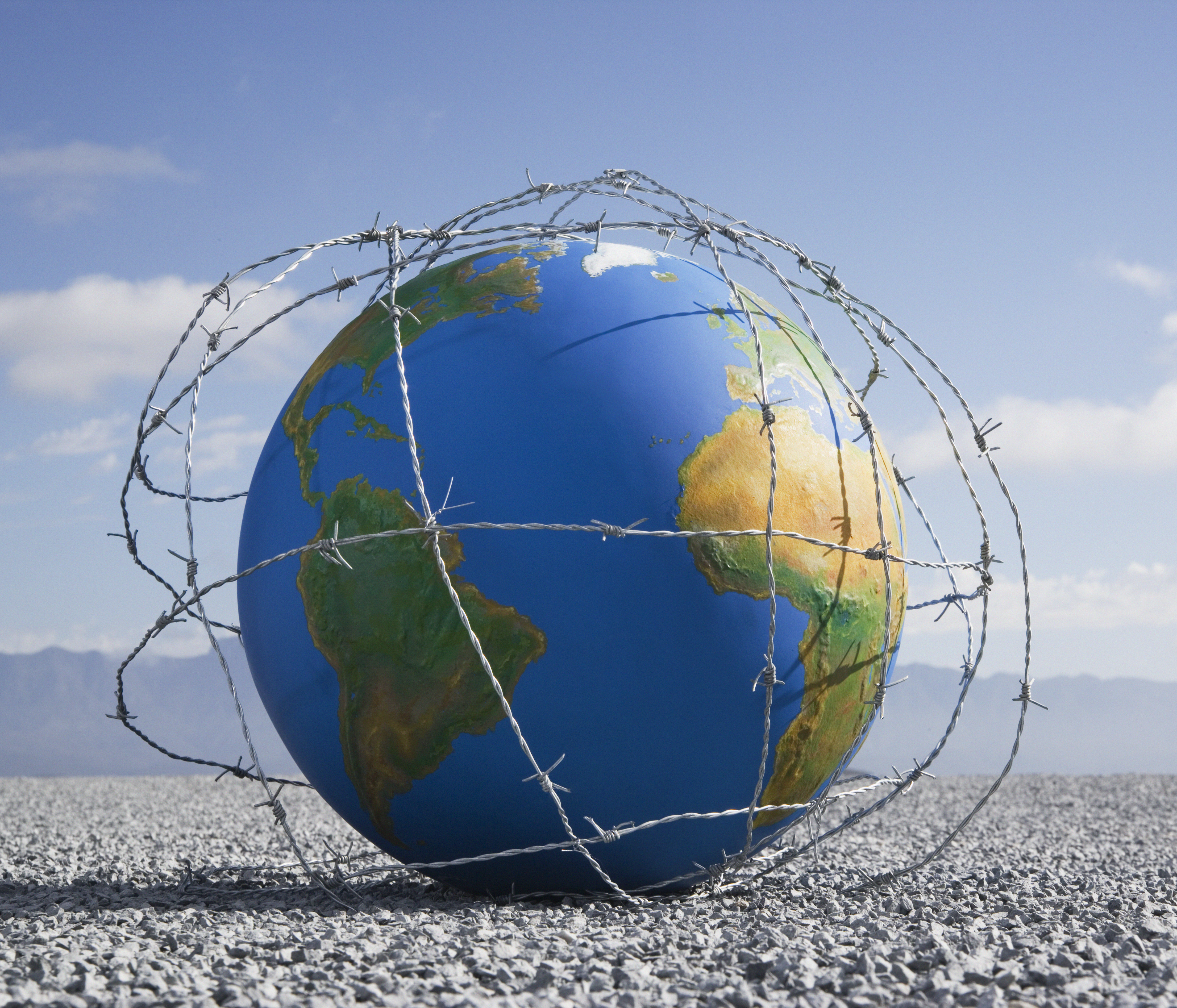 A globe entangled in barbed wire